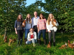 The Brass family with hens and trees