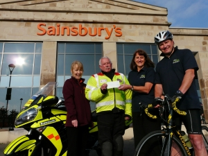 Cheque donation from Lakes Free Range Egg Co to Penrith Sainsbury's nominated charity Blood Bikes Cumbria