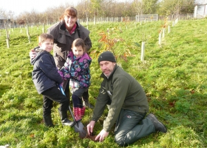 Pupils learn to plant trees with Helen and Paul