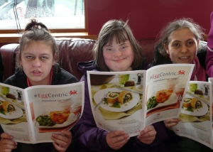 students look at #eggcentric recipe booklet