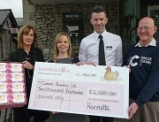CRUK cheque presented at Booths for sale of Laid With Love eggs