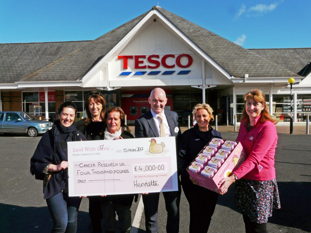 Laid With Love present cheque to CRUK with Tesco