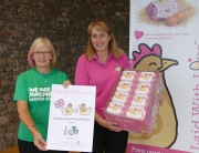 Macmillan receives eggs from Helen Brass