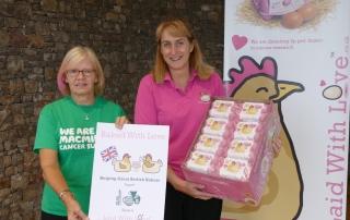 Macmillan receives eggs from Helen Brass